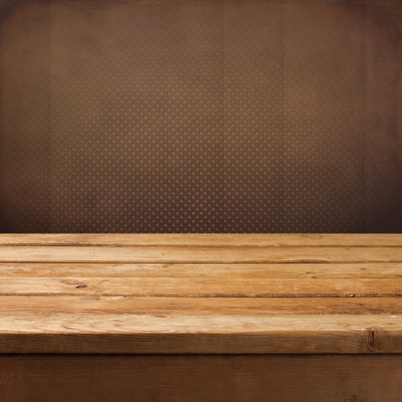 polka dot background: Vintage retro background with wooden table and wallpaper. Ready for product montage