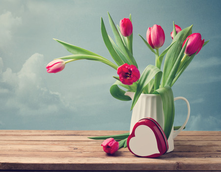 mothers day: Valentines Day concept. Beautiful tulip bouquet with heart shape box Stock Photo
