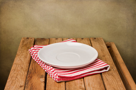 Background with empty plate and wooden table Stock Photo