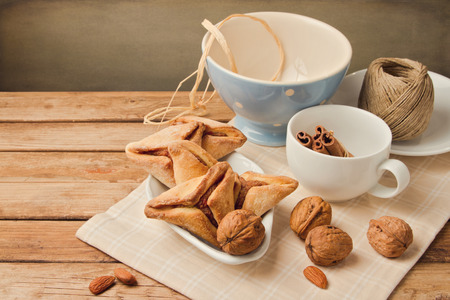 haman: Hamantaschen cookies forJewish festival of Purim on wooden table