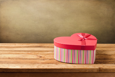 mothers day: Heart shape gift box on wooden table
