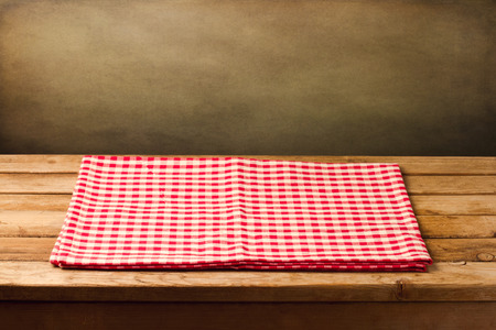 table wood: Empty table with tablecloth over grunge background