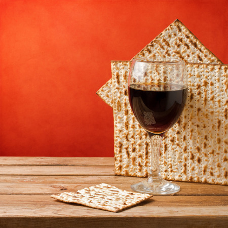 matzoth: Background with glass of wine and matza for passover celebration