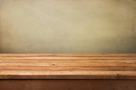 table surface: Vintage background with empty wooden table and wallpaper with zigzag pattern