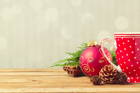 holiday decorations: Christmas holiday background with cofee cup, pine corn and ornaments