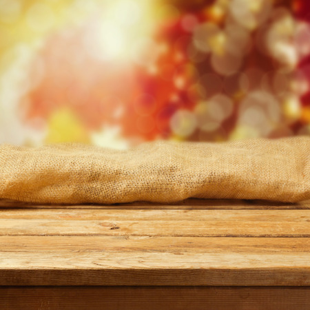 sack cloth: Autumn background with empty wooden deck table and sackcloth