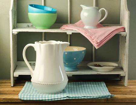 tableware life: Still life with tableware on vintage shelf