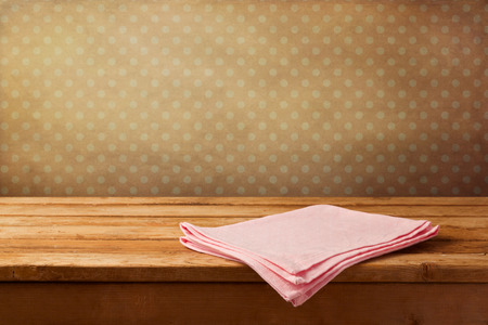 polka dots background: Empty wooden table with tablecloth over polka dots background Stock Photo