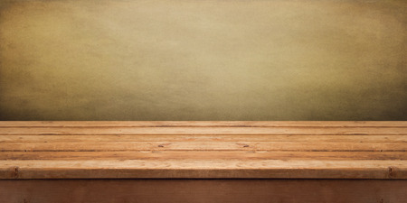 horizontal: Background with empty wooden deck table over grunge wallpaper