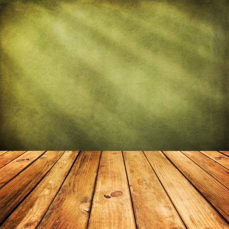 table surface: Wooden deck floor over green grunge background