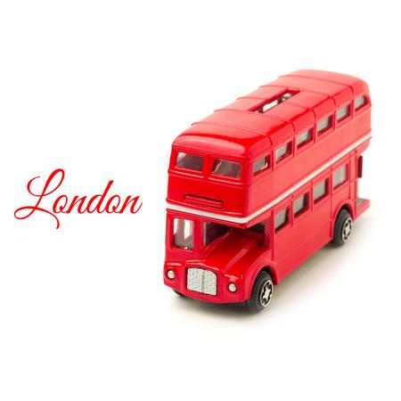 London bus money box toy isolated on white background Imagens