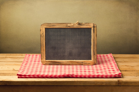 grunge interior: Vintage background with chalkboard on tablecloth Stock Photo