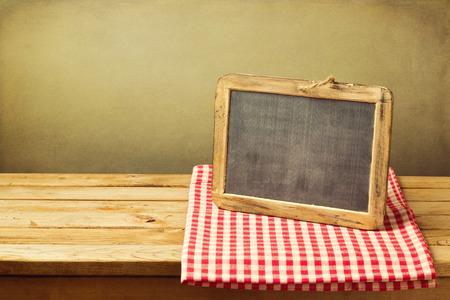page background: Chalkboard and tablecloth on wooden table over grunge background