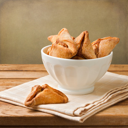 hamantaschen: Hamantaschen cookies for Jewish festival of Purim on wooden table Stock Photo