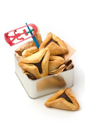 hamantaschen: Hamantaschen cookies and grogger for Jewish festival of Purim