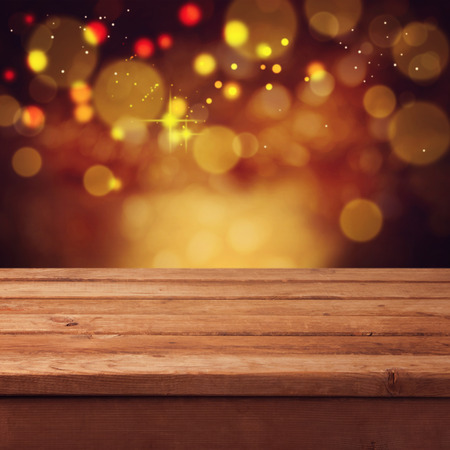 background cover: Christmas bokeh background with empty wooden table Stock Photo