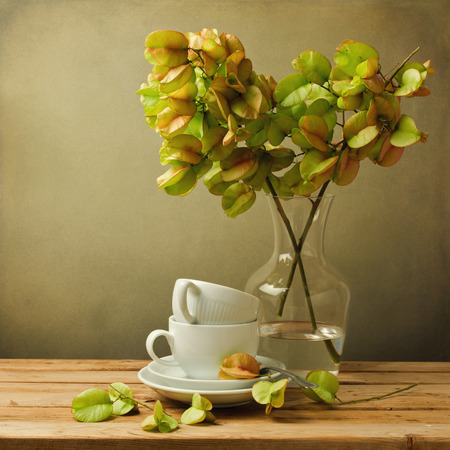 Vintage still life with autumn golden tree and coffee cups photo