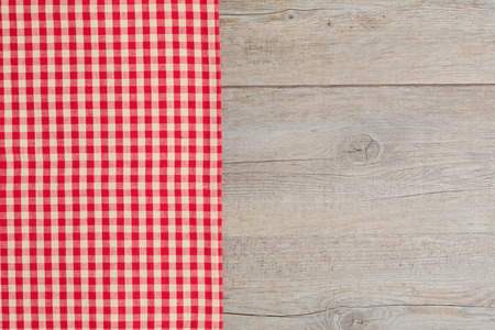 tablecloth: Wooden table covered with red checked tablecloth. View from the top. Stock Photo
