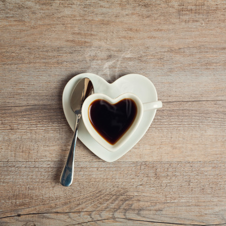 hearts: Heart shape coffee cup on wooden table