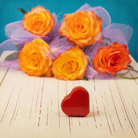 flower shape: Heart shape box over roses flower bouquet