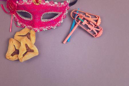 haman: Hamantaschen cookies, grogger and carnival mask