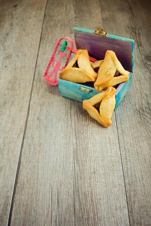 haman: Haman ears cookies and grogger for Jewish festival of Purim