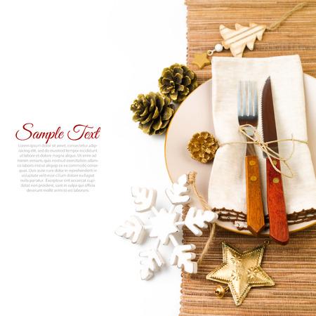 kine: Christmas table setting with plate, kine, fork and decorations
