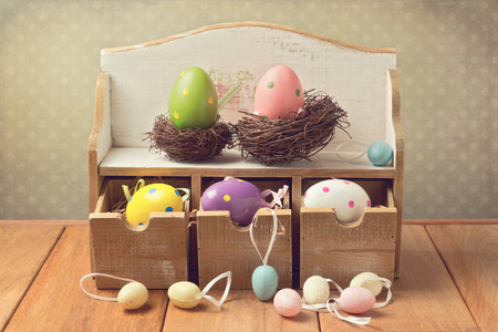 easter eggs: Easter eggs decorations on wooden table over retro background