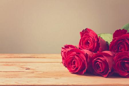 feminine background: Background with red roses Stock Photo