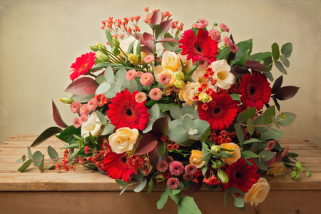 gebera: Beautiful flower bouquet on wooden table over grunge background