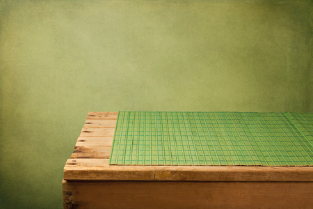 empty table: Retro background with empty wooden table and placemat Stock Photo