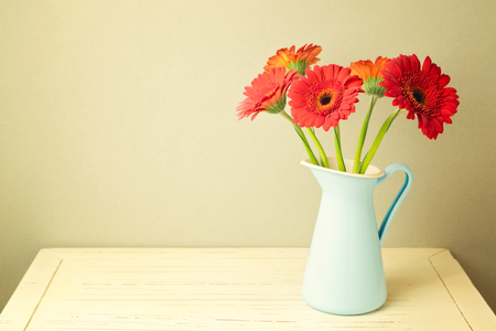 valentines day mother s: Gerbera daisy flowers on wooden white table Stock Photo