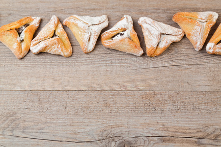 hamantaschen: Hamantaschen cookies for Jewish festival of Purim on wooden background Stock Photo