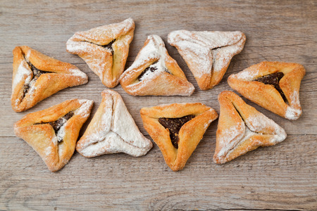 haman: Hamantaschen cookies for Jewish festival of Purim on wooden background Stock Photo