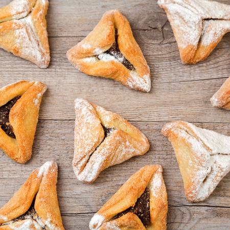 hamantaschen: Hamantaschen cookies on wooden background Stock Photo