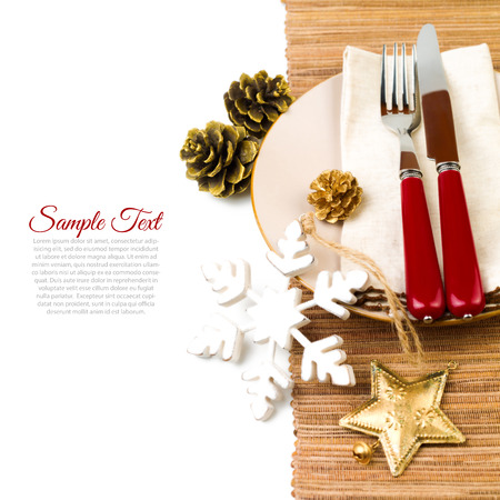 setting: Christmas table setting with plate, kine, fork and decorations