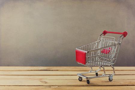 cart: Shopping cart on wooden surface