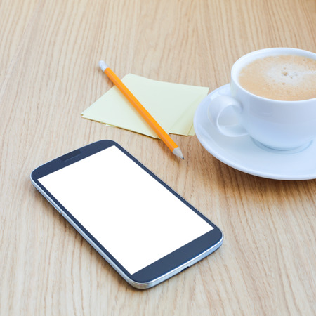 mobile marketing: Modern workplace with mobile phone, pencil, cup of tea and note papers