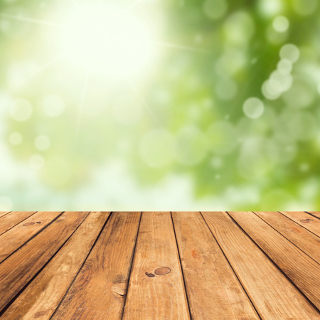 deck: Vintage wooden planks over bokeh green background
