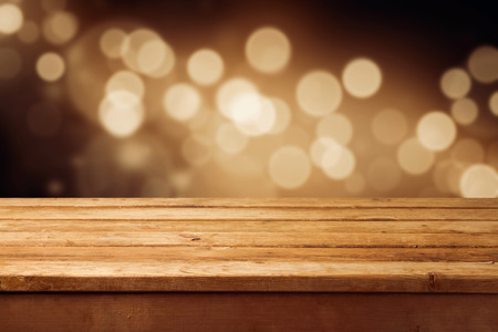 defocused: Bokeh background with empty wooden deck table for product montage display