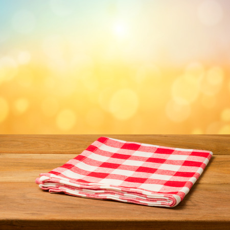 tablecloth: Vintage background with wooden table and tablecloth over bokeh background