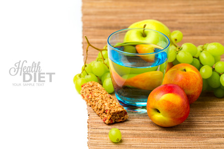 healthy snack: Water, healthy snack bar and fruits over white background Stock Photo