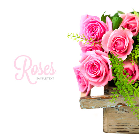 rose bouquet: Rose flowers bouquet in wooden box on white background