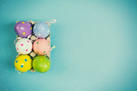 Easter eggs decoration on blue background with retro filter Stock Photo