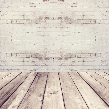 brick floor: Empty room with wooden floor and white brick wall Stock Photo