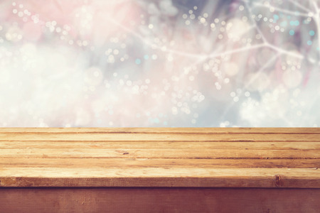 Christmas holiday with empty wooden deck table over winter bokeh. Ready for product montage