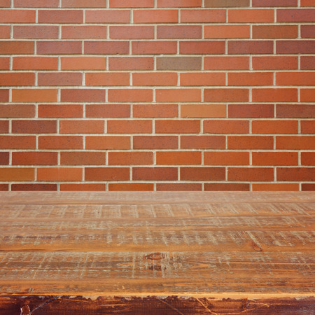 materia: Empty wooden table over brick wall