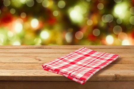 bokeh: Christmas empty wooden table with tablecloth for product montage display Stock Photo