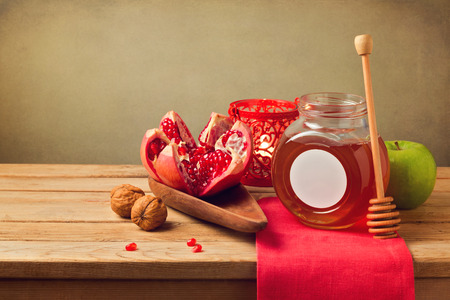 Pomegranate and honey for Rosh Hashanah holiday. Jewish New Year. Stock Photo