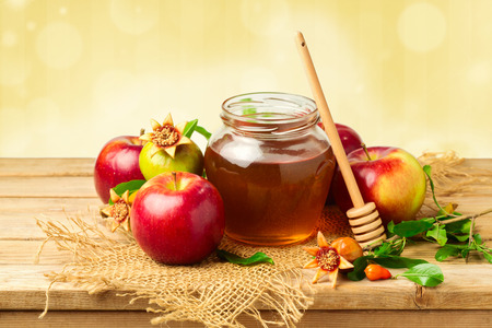 jewish food: Honey jar with apples and pomegranate for Jewish New Year Holiday Stock Photo